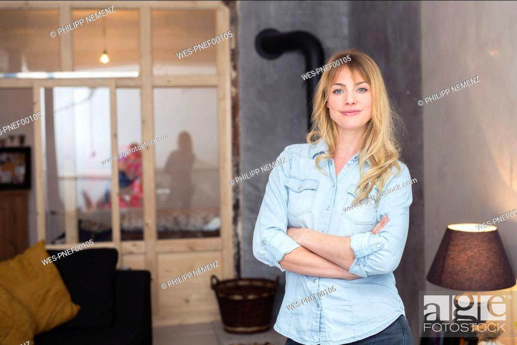 Stock Photo: Portrait of confident blond woman at home.