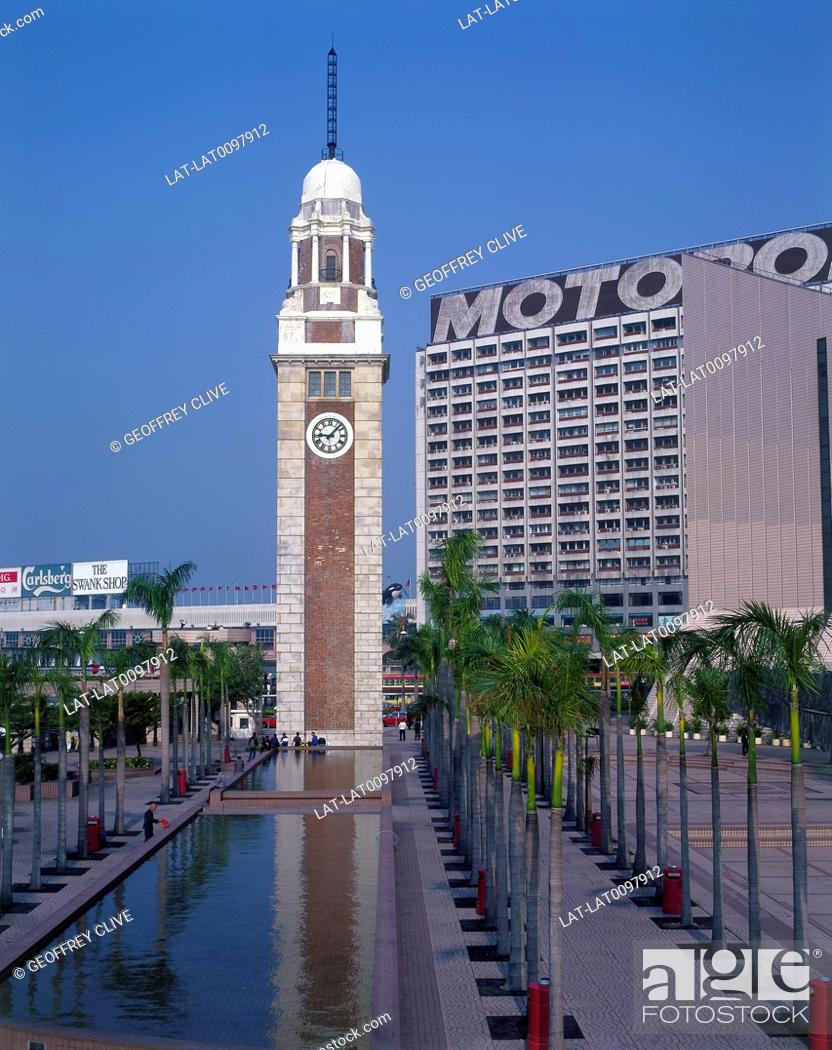 Clock tower  Pool  Lines of palm trees  Motorola sign on building