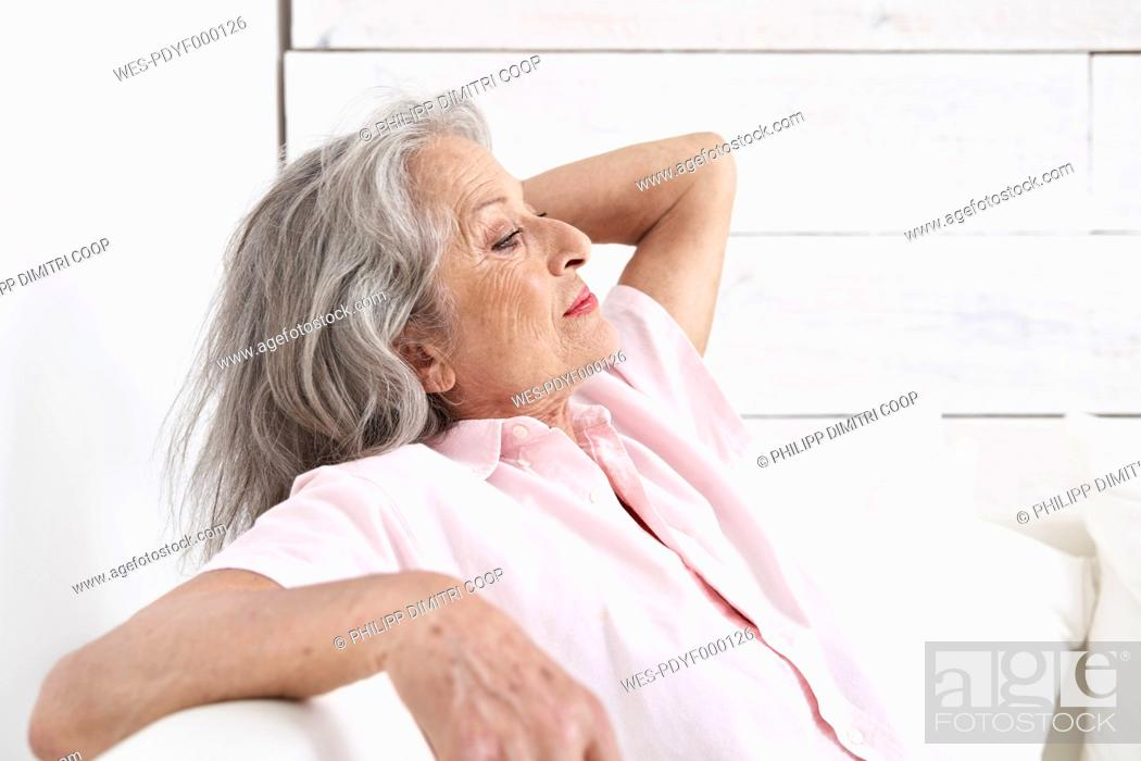 Stock Photo: Spain, Senior woman relaxing on couch.