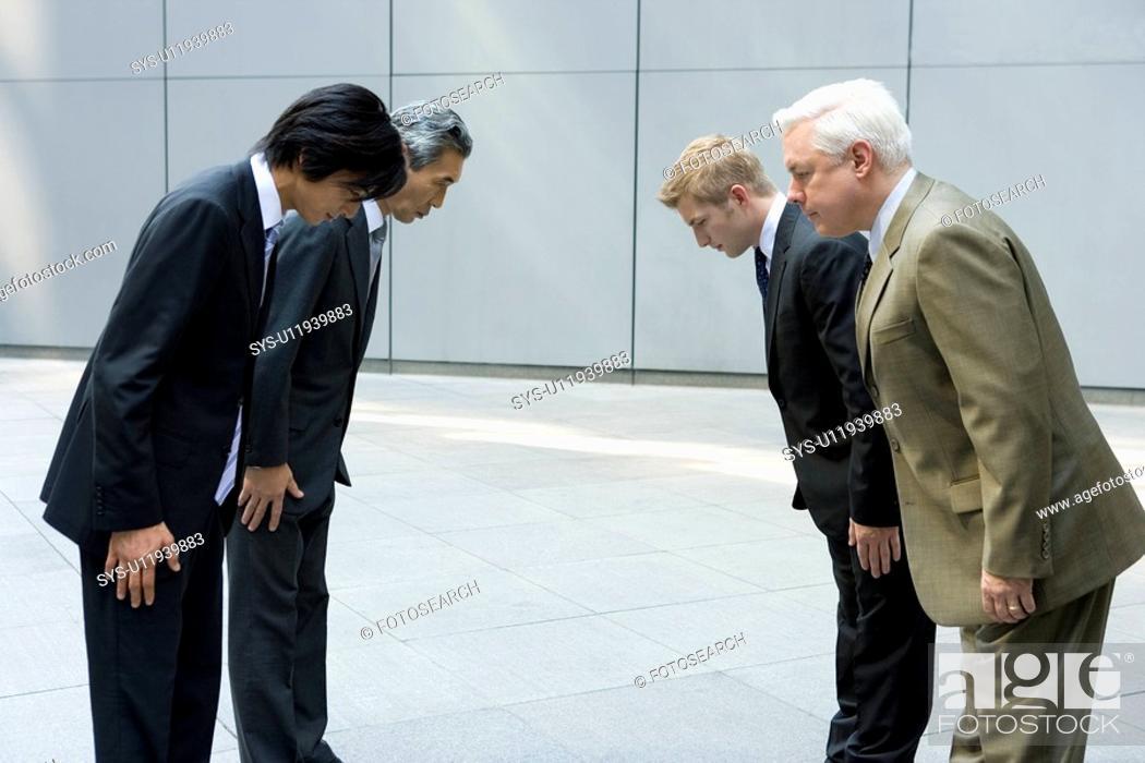 Stock Photo: Businessmen Bowing.