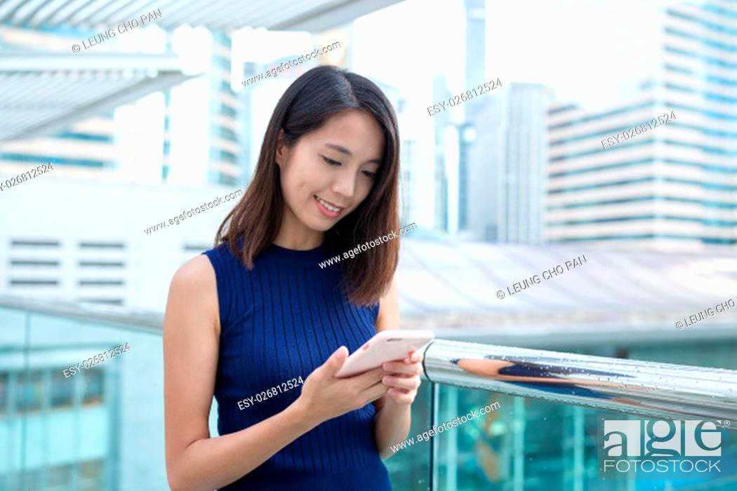 Stock Photo: Young woman use of mobile phone.