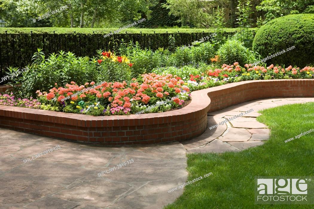 Garden Raised Brick Flower Beds Flagstone Walkway Along Edge Of