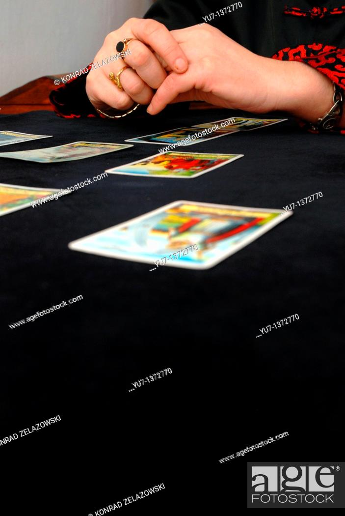 Stock Photo: Fortune teller reading the tarot cards.