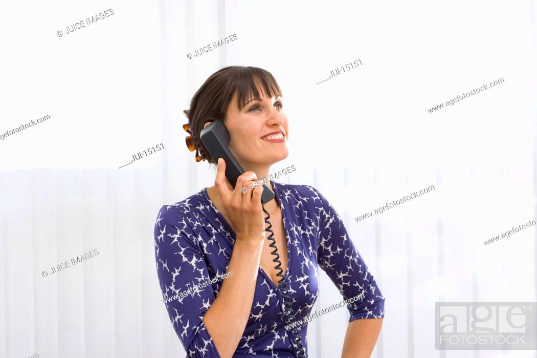 Stock Photo: Woman on telephone, smiling.