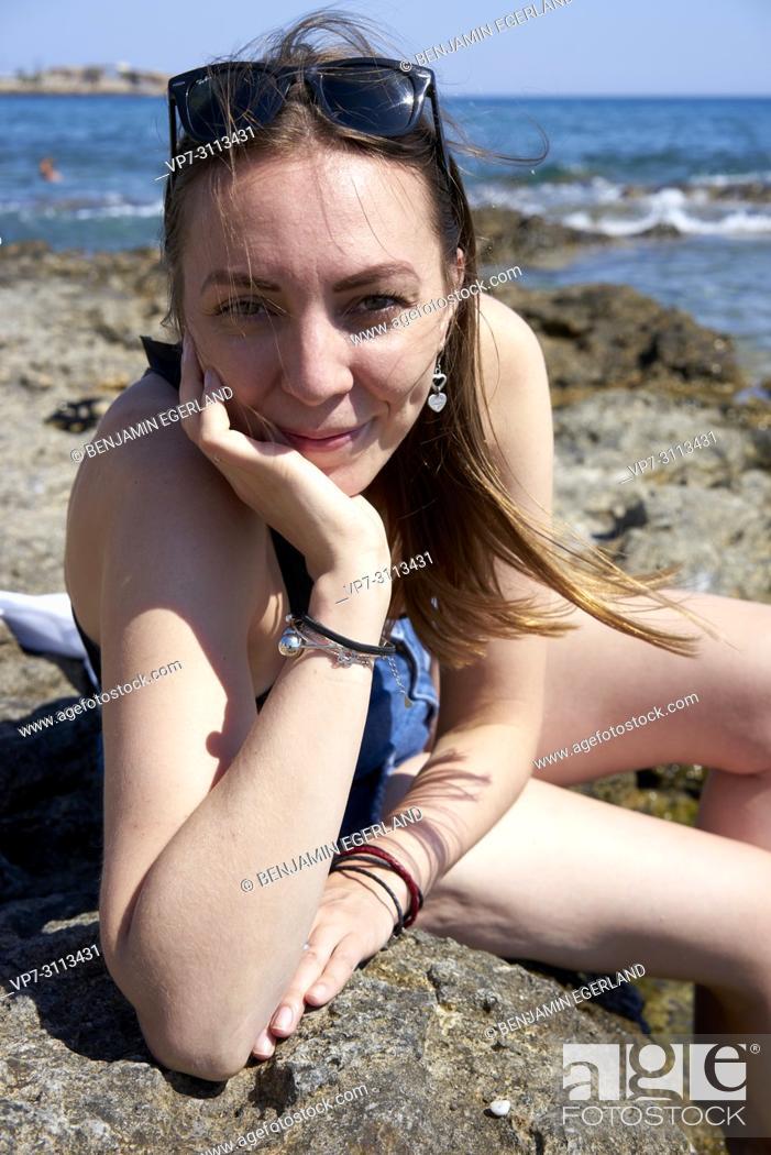Stock Photo: portrait of woman at seaside. Crete, Greece.