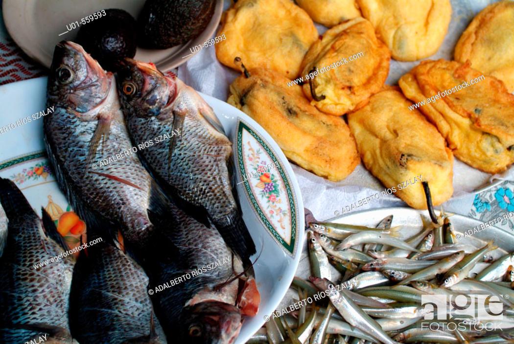 Stock Photo: Restaurant: common fishes (mojarras, charales) in Zirahuen Lake region and stuffed chilies. Michoacan, Mexico.