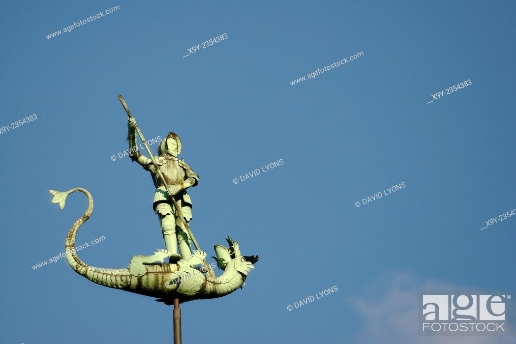 Stock Photo: Gdansk Poland. Saint George slaying the dragon. Statue on top of spire of 15th C. St. Georges Hall in the Old Town.