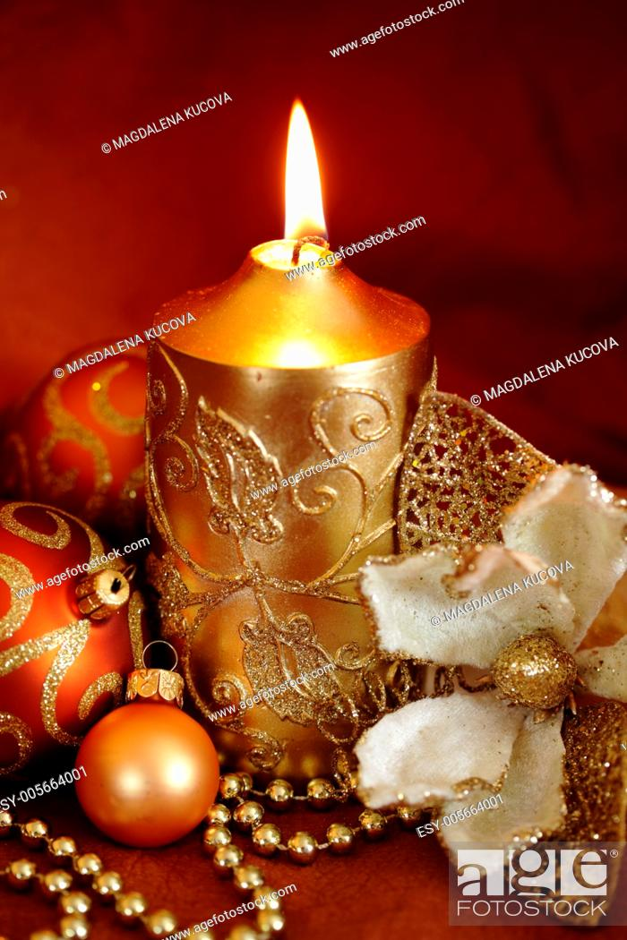 Stock Photo: Christmas still life - candle, decorative flower and ornaments.
