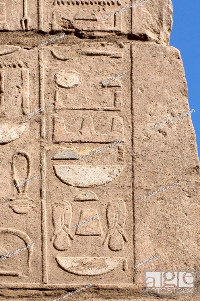 Stock Photo: Luxor, Karnak, Egypt.Temple of Karnak sacred to god Amon: sculptures in a wall.