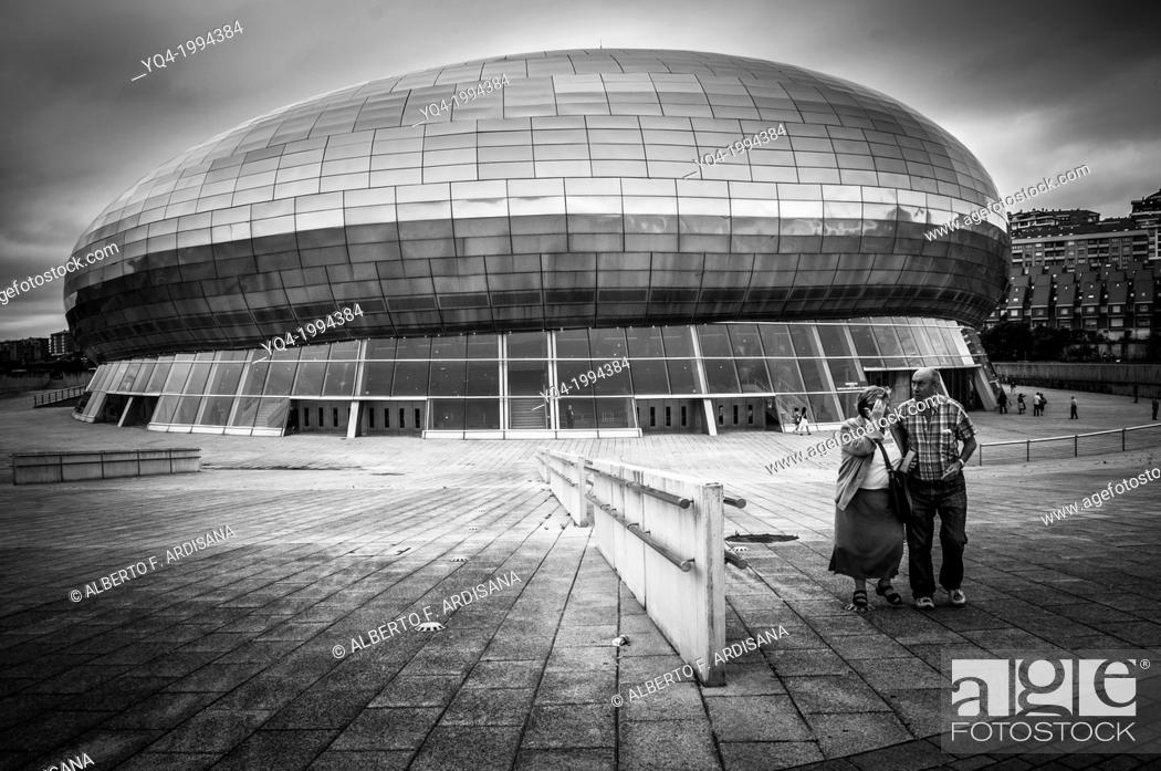 Stock Photo: Santander Sports Palace. Two people in the foreground. Black and white photography.