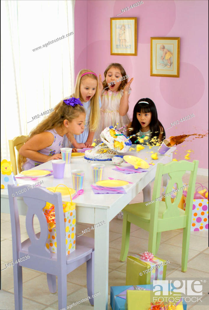Stock Photo: 6-10 year old girls. Cake was stripped in.