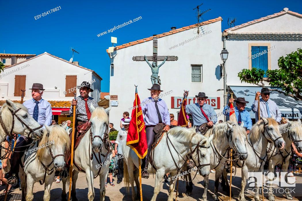 Stock Photo: Sent-Mari-de-la-Mer, Provence, France - May 25, 2015. World Festival of Gypsies. Convoy - guards on white horses before the start of the parade.