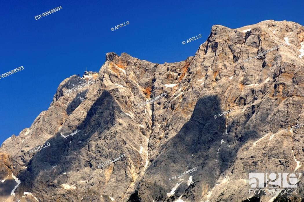Stock Photo: Crest of the Wetterstein mountain range with Mt  Zugspitze and the upper station of the Tyrol Zugspitze cable car, Ehrwald, Tyrol, Austria.
