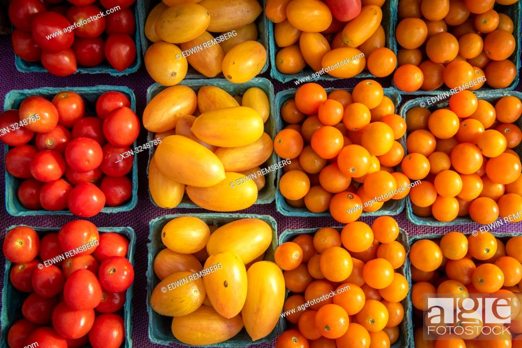 Imagen: High angle view of cartons full of red, yellow and orange cherry tomatoes (Solanum lycopersicum var. cerasiforme) for sale at farmers' market, Rehoboth Beach.