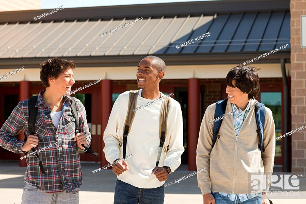 Stock Photo: High school students outside school building.