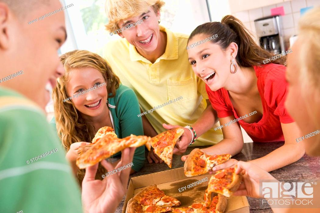 Stock Photo: Group Of Teenagers Eating Pizza.