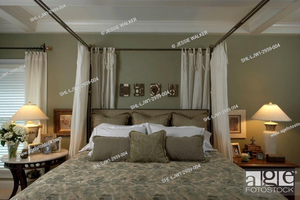 Picture of: Bedroom With Metal Frame Four Poster Bed Grey Walls And Grey Pattern Bedspread Stock Photo Picture And Rights Managed Image Pic Shl Ljw1 2959 004 Agefotostock