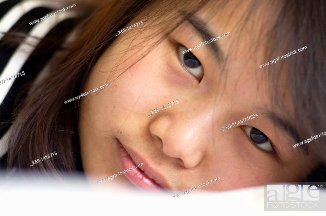 Stock Photo: Portrait of Asian girl.