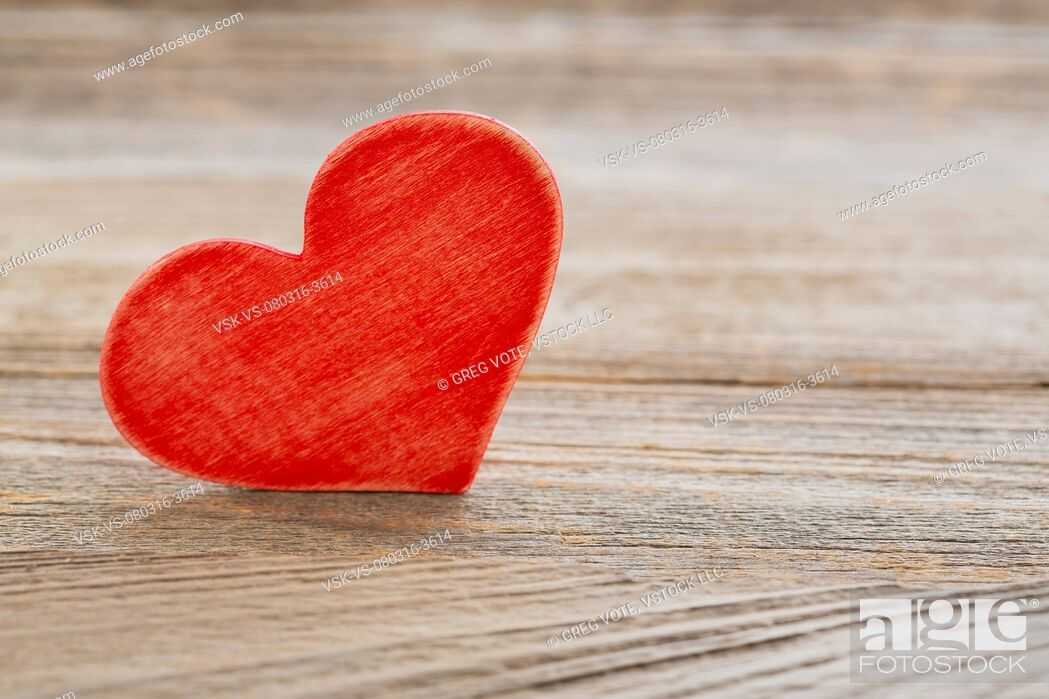 Stock Photo: Red heart on wooden surface.