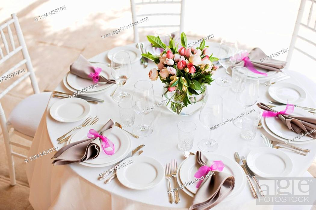 Stock Photo: Place setting and centerpiece at wedding reception.