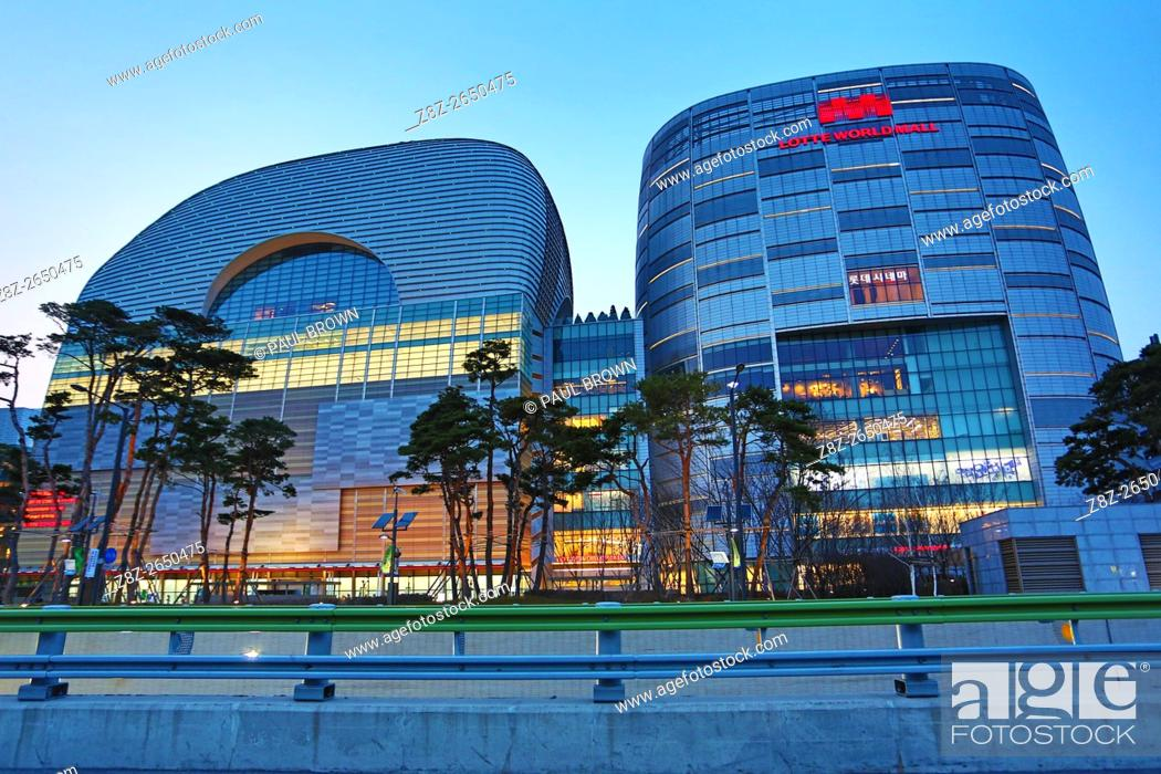 Stock Photo: The Lotte World Tower and the Lotte World Mall at sunset in Jamsil in Seoul, Korea.