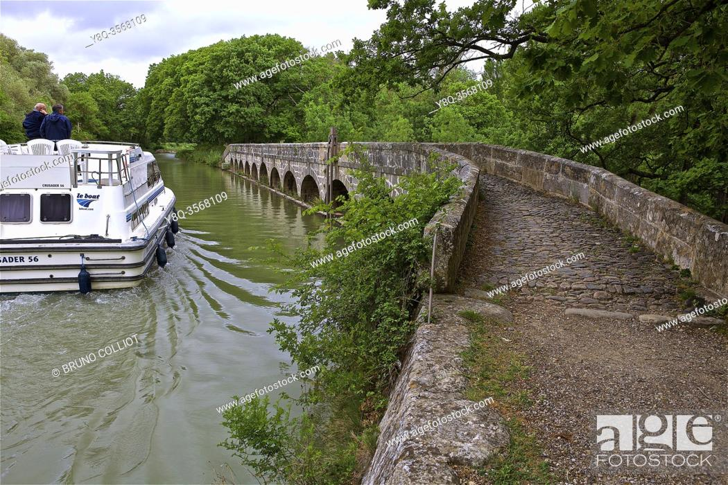Stock Photo: the Redorte outfall, Argent-Double canal bridge, The Argent-Double canal bridge is one of the many bridges of this type on the Canal du Midi.