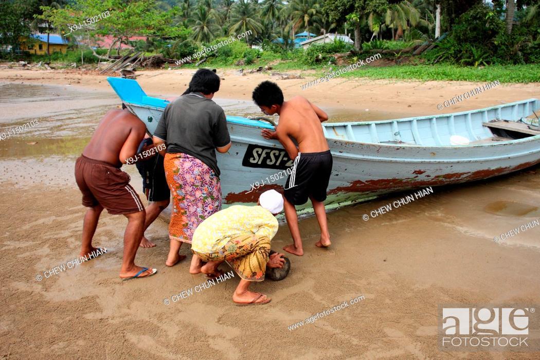 Stock Photo: Fishermen with a boat, Teluk Melano, Sarawak, Borneo.