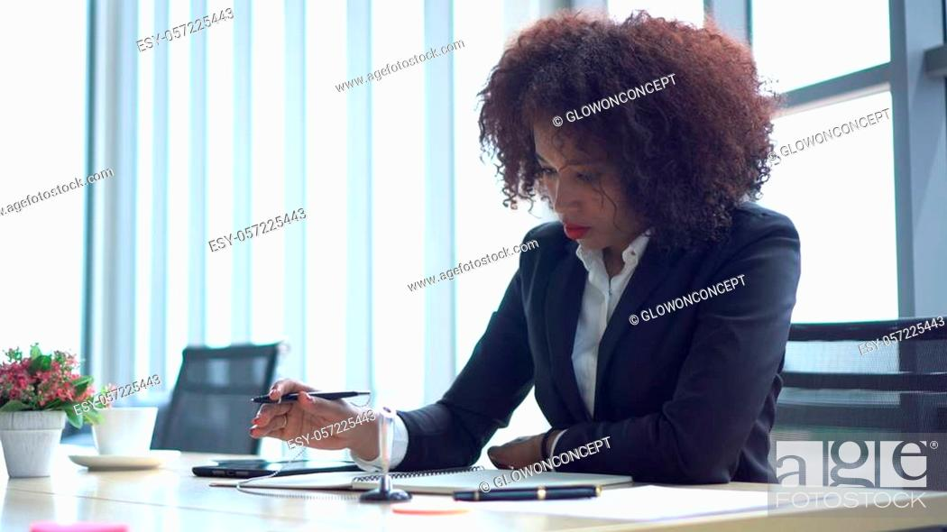 Stock Photo: African young business woman working on strategy modern office.