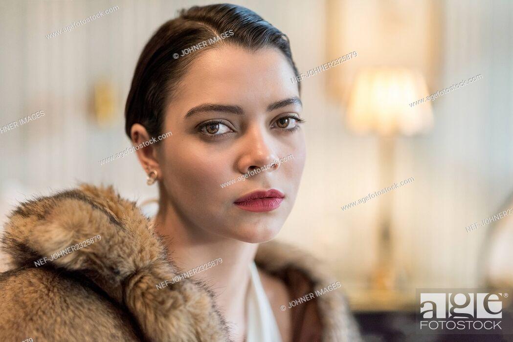 Stock Photo: Woman looking at camera.