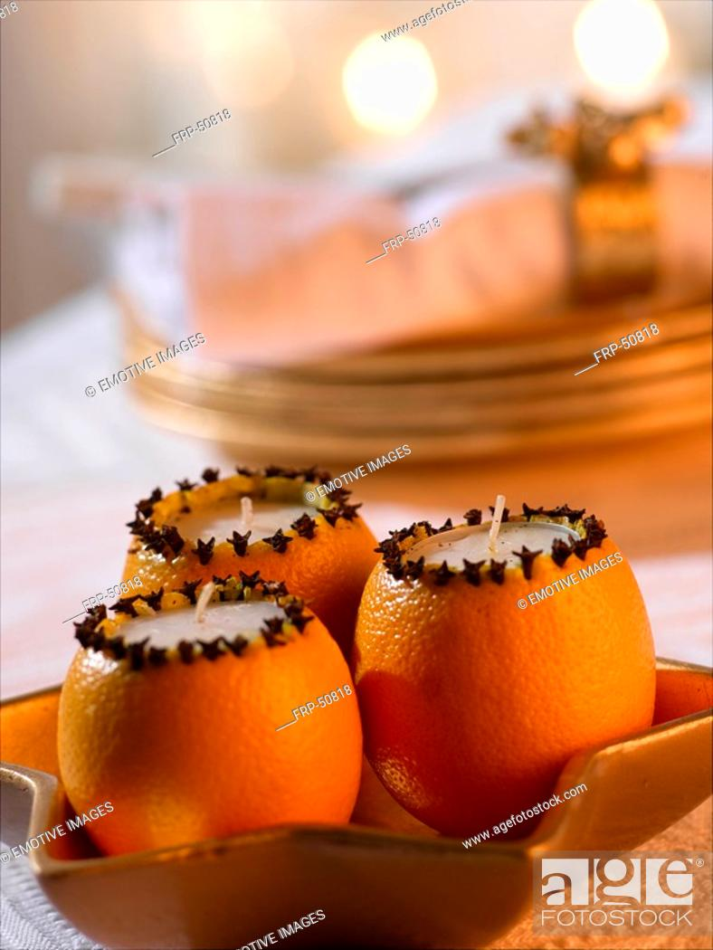 Stock Photo: Orange clove candle.