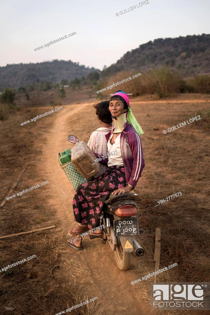 Stock Photo: A Kayan woman riding on a motorbike in a dirt road, Kayah State, Myanmar.