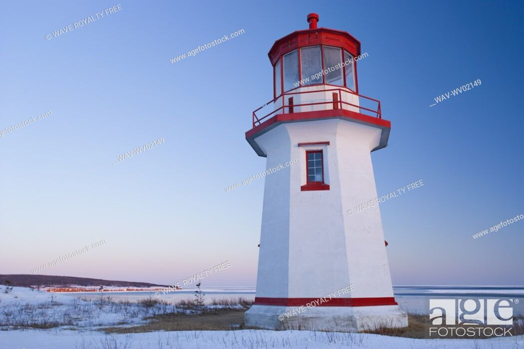 Stock Photo: View of Cap Blanc lighthouse and Île Bonaventure at sunset, Quebec.