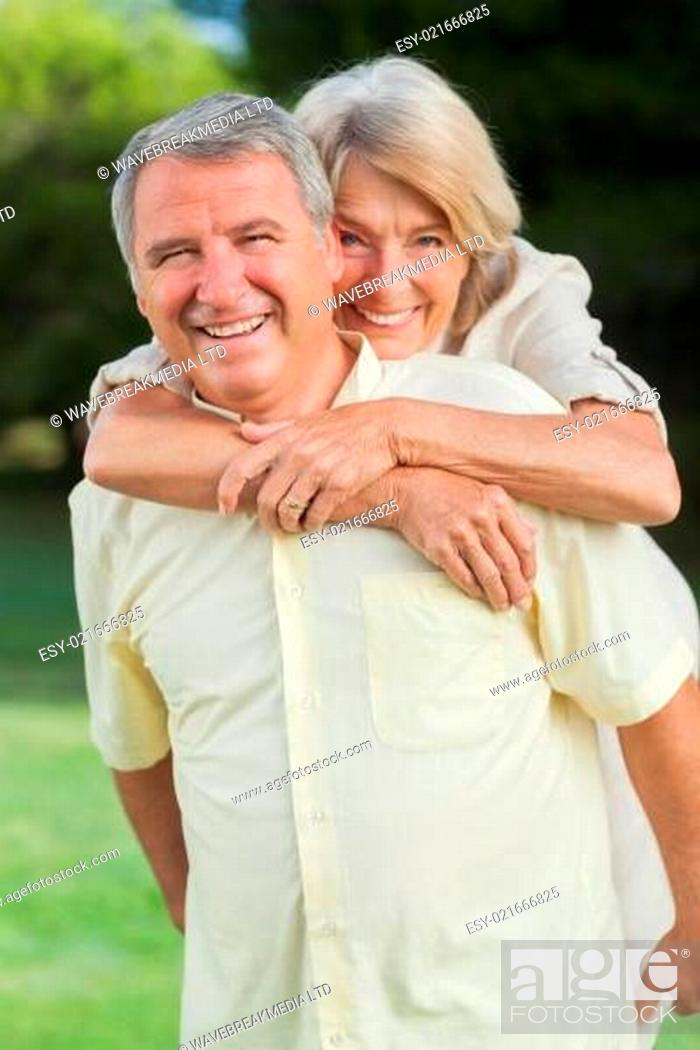 Portrait Of Older Couple Having Fun And Laughing Outside In The