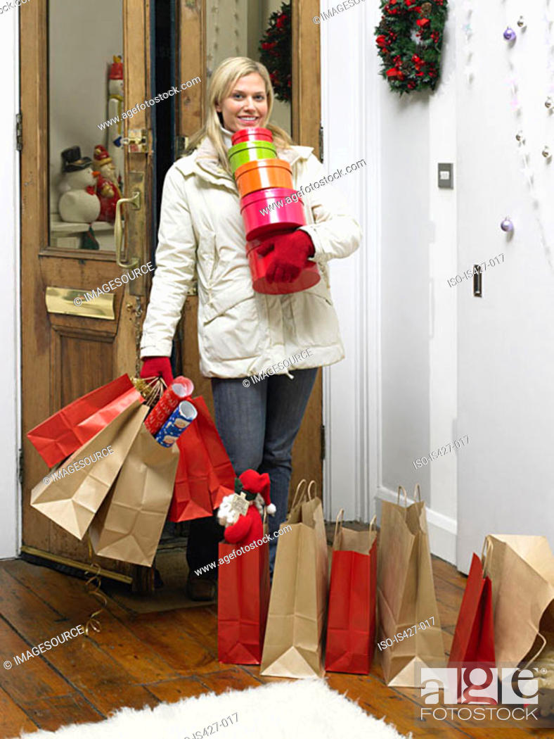 Stock Photo: Woman returning home from christmas shopping.