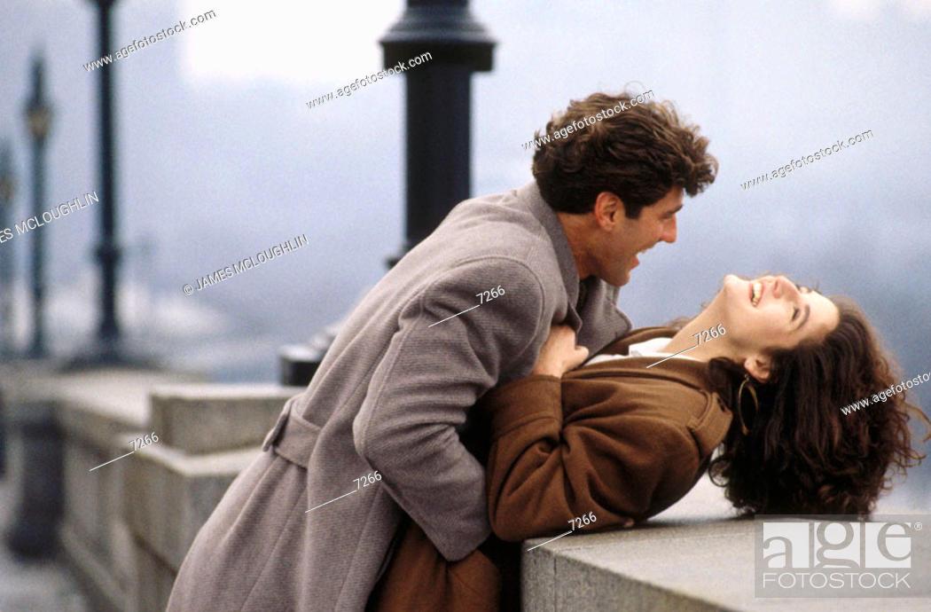 Stock Photo: Couple on bridge.