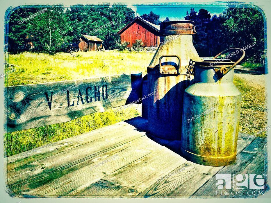 Stock Photo: Milk churns outside farm, Ljustero, Sweden, Scandinavia.