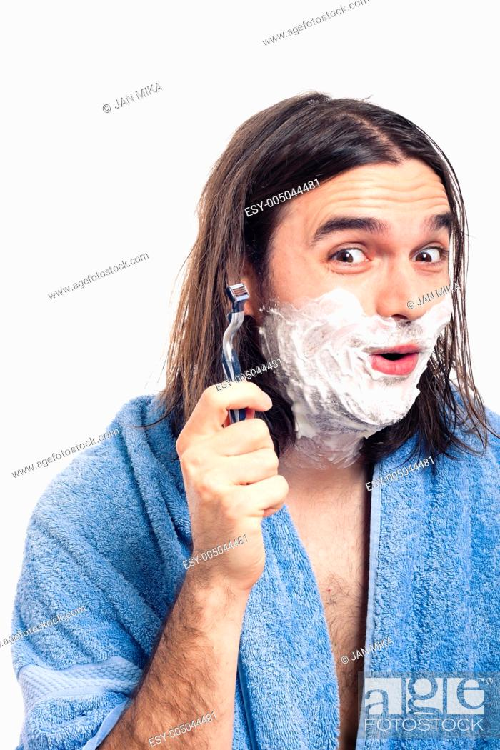 Stock Photo: Happy funny longhaired man going to shave after bath, isolated on white background.