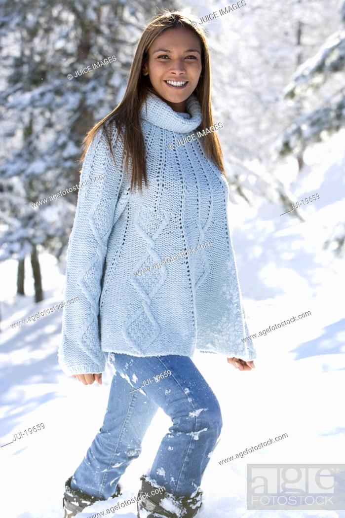 Stock Photo: Portrait of young woman standing in snow.