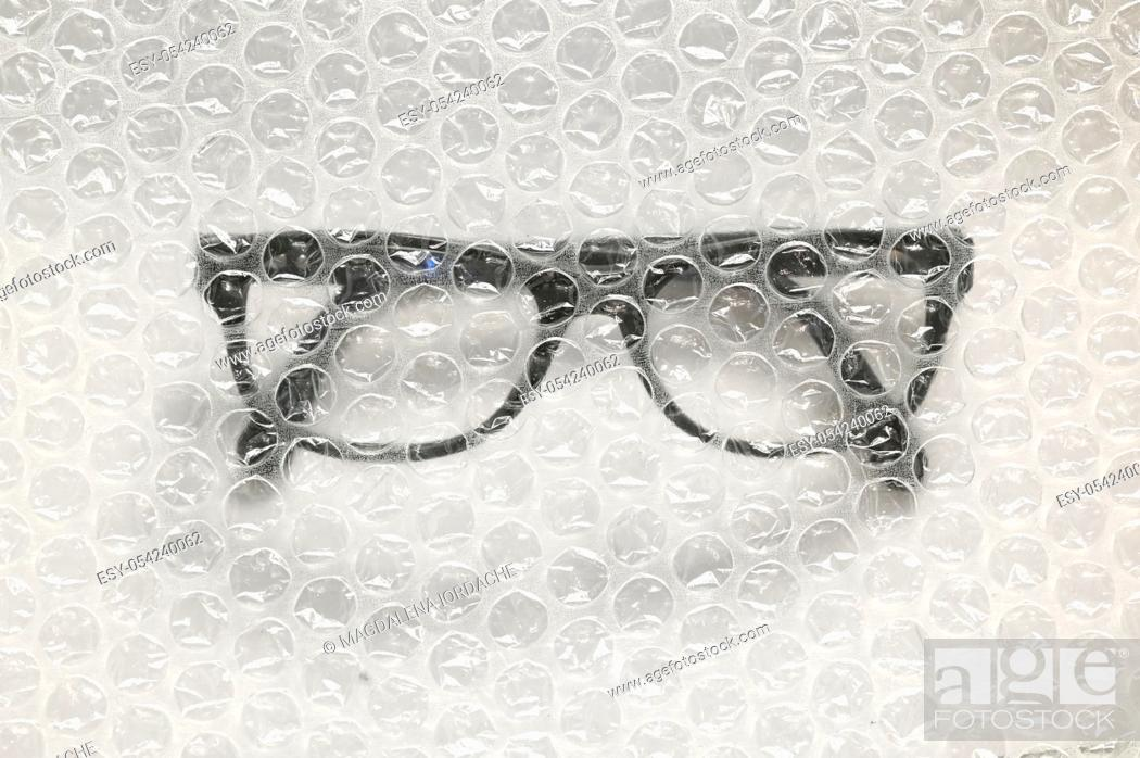 Stock Photo: Abstract Bubble Wrap and Glasses.