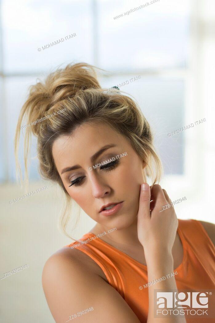 Stock Photo: Beautiful young woman hand touching neck.