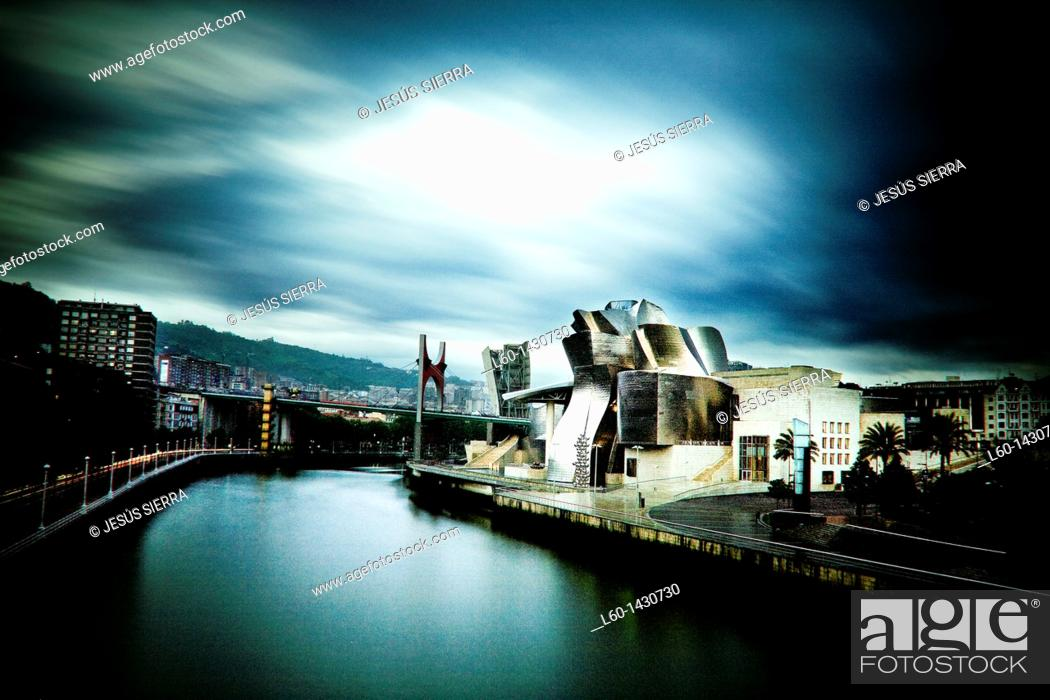 Stock Photo: Guggenheim Bilbao Museum by Architect Frank Gehry, Nervion River, Bilbao, Province of Biscay, Basque Country, Spain.