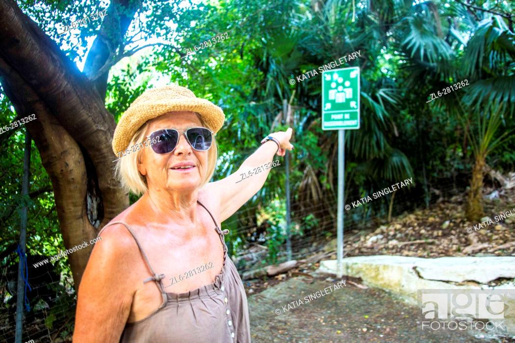 Stock Photo: Senior retirred caucasian woman in her 60's, 70's doing the road of christ in Martinique.