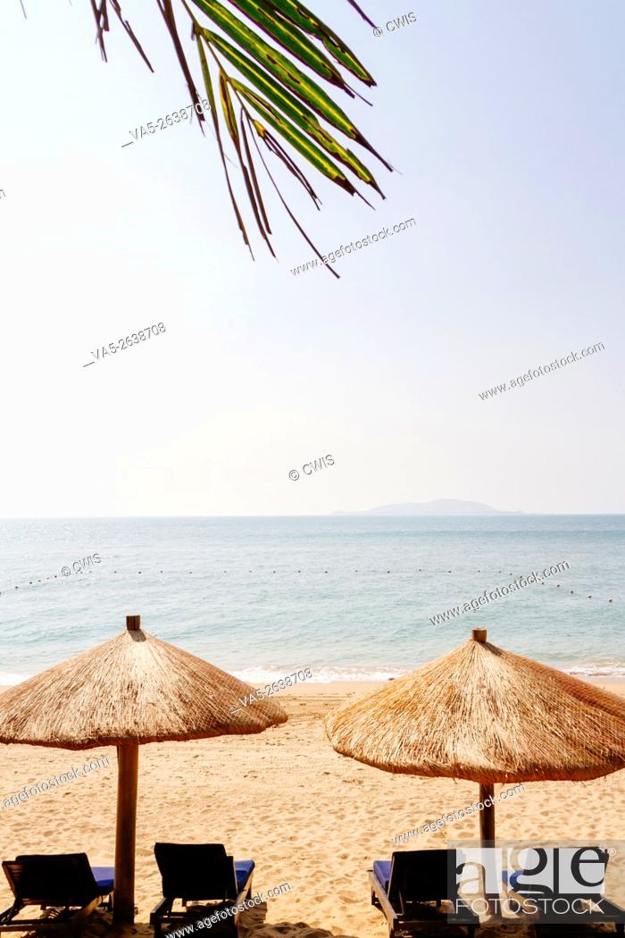 Stock Photo: Sanya, Hainan island, China - The view of beautiful beach in the daytime with beach chair.