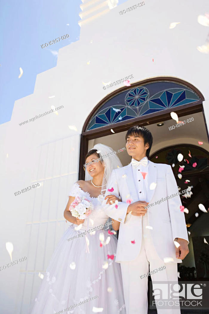 Stock Photo: Confetti showering upon newlyweds.