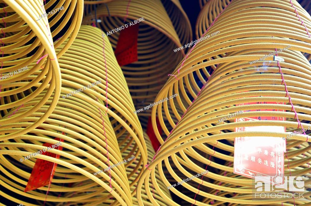 Stock Photo: hanging spiral joss incense  Pak Tai Temple  Taipa Village  Macau  China.