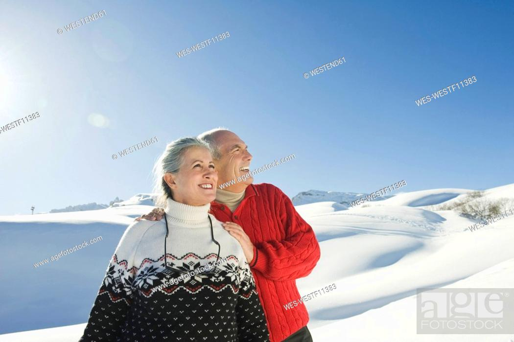 Stock Photo: Italy, South Tyrol, Seiseralm, Senior couple in winterly landscape.