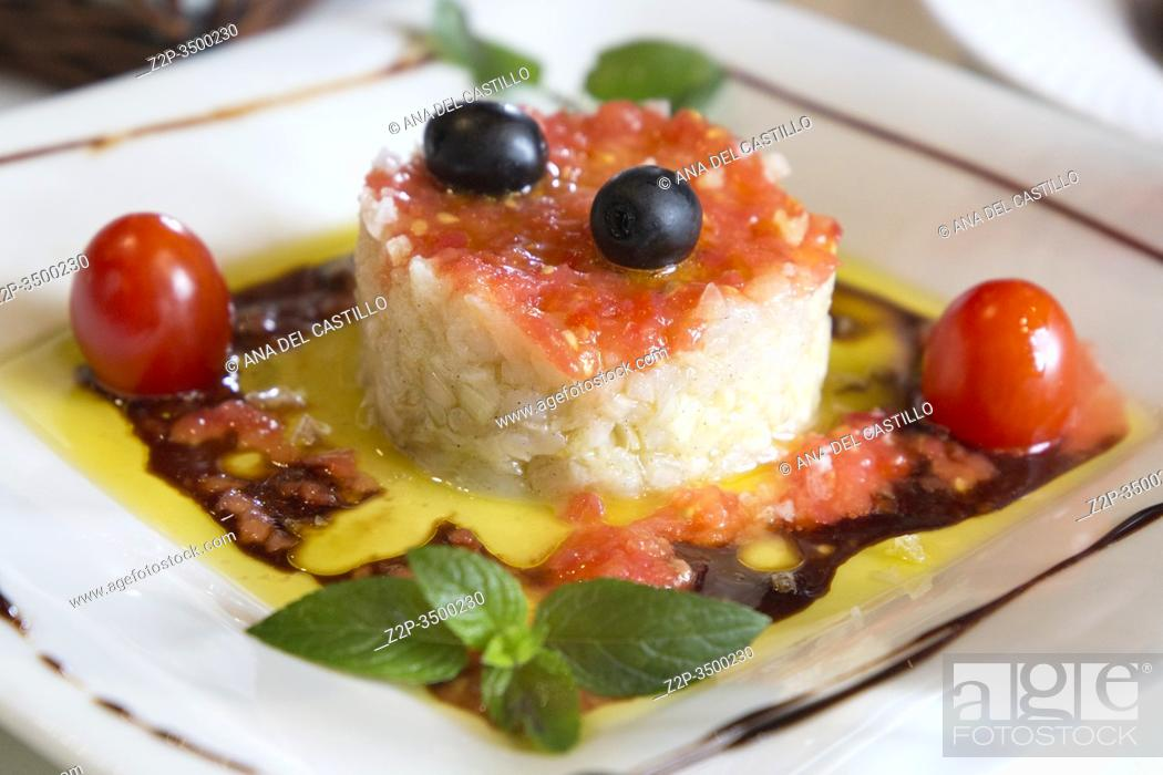Stock Photo: Cod fish salad with tomato and olive oil decorated with mint leaf Spain.
