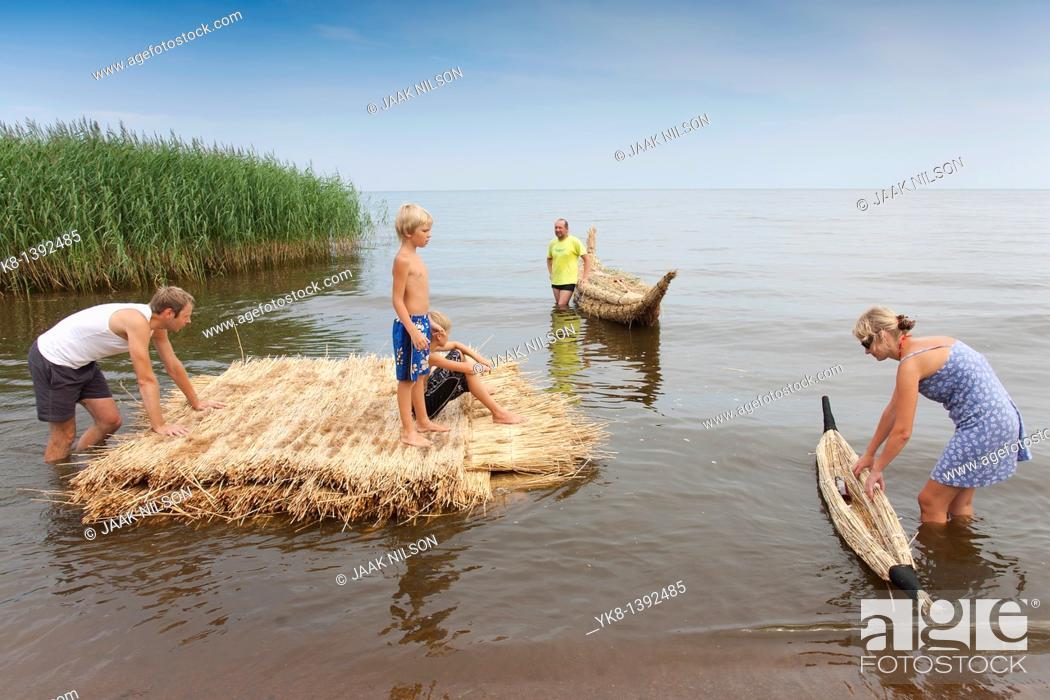 Stock Photo: People on Reed Boat and Reed Mat, Lake Peipsi, Estonia, Europe.