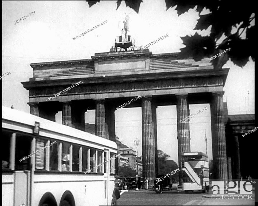 Imagen: Buses Driving Down a Road with the Brandenburg Gate in the Background in Berlin, Germany - Germany.