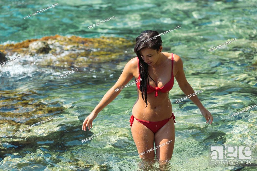 Stock Photo: Woman with red bikini on the beach.